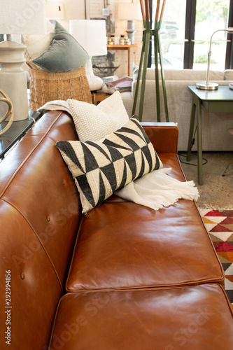 Photo Brown Leather Sofa with Accent Pillow