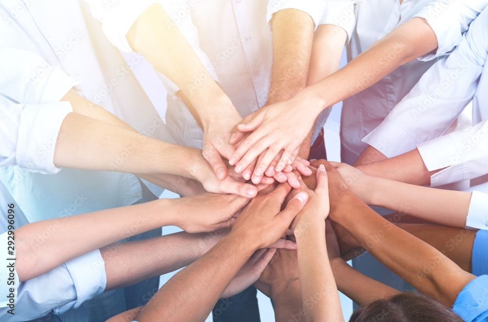 Fototapeta Close-up view of group of people stacking hands