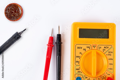 Multimeter with probes on a white background Wallpaper Mural