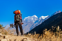 Male Trekker In Himalayan Mountains And Forests In Manaslu Region, Nepal.
