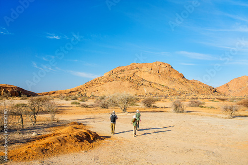 Family hiking in Spitzkoppe Namibia