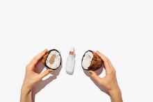 Organic Coconut Oil Bottle Between Woman's Hands