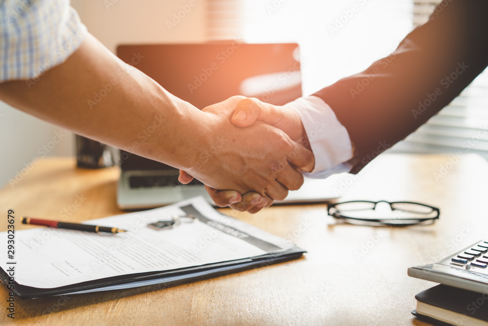 Fototapeta Partners corporate relationship concept. Close up handshake of business people in meeting attendance.