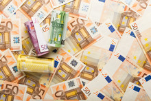 Rolls Of Euro Banknotes On Sca...
