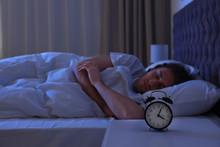 Alarm Clock On Nightstand Near...
