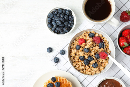 Tasty breakfast served on white wooden table, flat lay