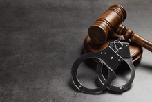 Judge's Gavel And Handcuffs On...