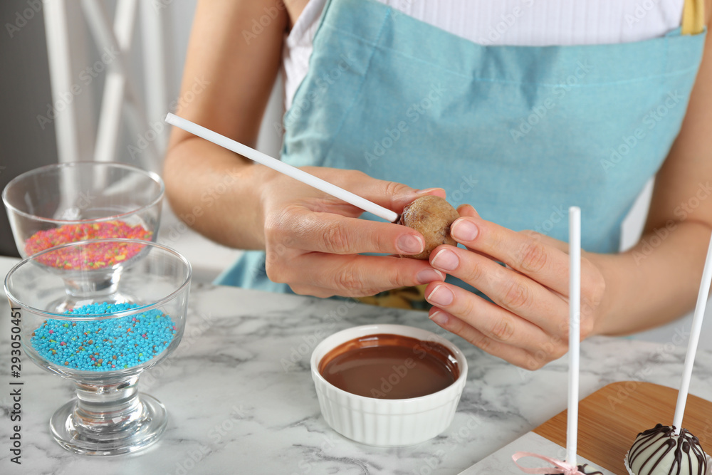 Fototapety, obrazy: Young woman with cake pop and chocolate frosting at white marble table, closeup