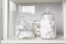 Cotton Balls, Swabs And Pads On White Shelf In Bathroom