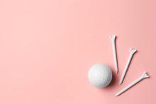 Golf Ball And Tees On Pink Bac...