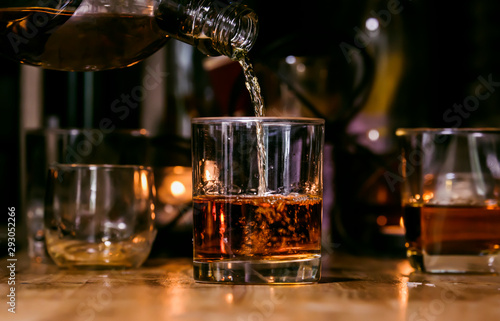 Bartender Serve Whiskey, on wood bar, Canvas Print