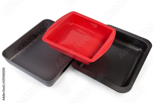 Valokuva  Empty metal nonstick and silicone baking trays on white background