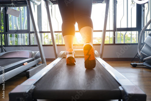 Deurstickers Jogging leg of fat woman being run or jog on belt of treadmill machine
