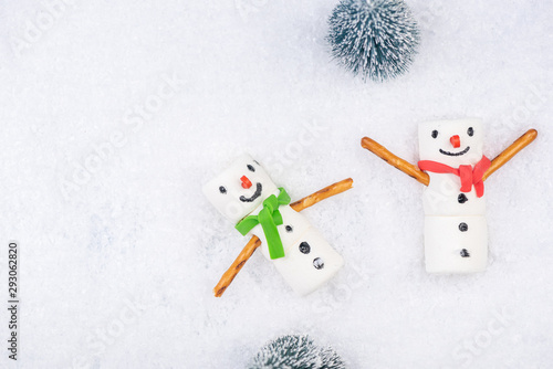 Marshmallow Funny Snowman Play in Snow. Festive Christmas Creative Concept Card.