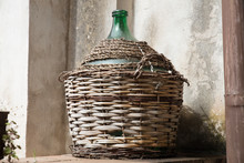 Empty Carboy In Rustic House
