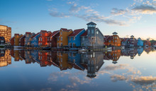 Tranquil Dawn At Colorful Wooden Houses In A Small Harbor In The Netherlands.  Living At The Waterfront In Groningen.