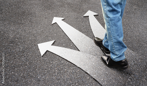 Obraz Business man standing on floor with three arrows, left, right and front. Feet and white arrow sign on road. Different direction and success concept. Businessman walking in black leather shoes. - fototapety do salonu