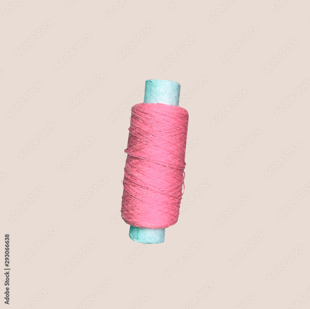 Fototapety, obrazy: Roll of Twine isolated on a beige Background. Skein of thread for needlework and sewing. Pink accessories for sewing on brown background. Needlework and craft concept. Gentle concept pictures. Banner