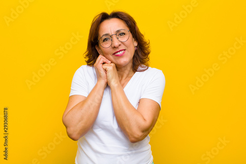 Valokuvatapetti middle age woman feeling in love and looking cute, adorable and happy, smiling r