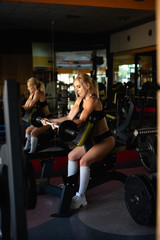 girl intensifies raises the bar with her hands, exercise is performed while sitting, active lifestyle