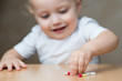 defocused little girl heading for pills left by adults, copy space