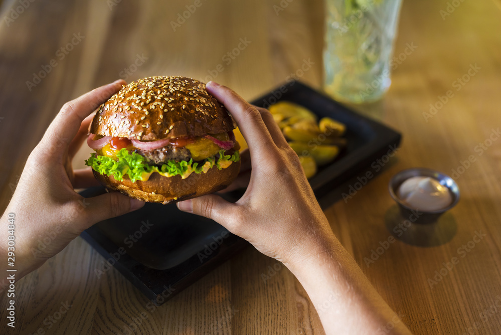 Fototapety, obrazy: Hands holding tasty beef burger with lettuce