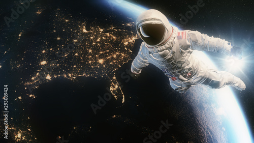 Astronaut in Orbit above Planet Earth and USA