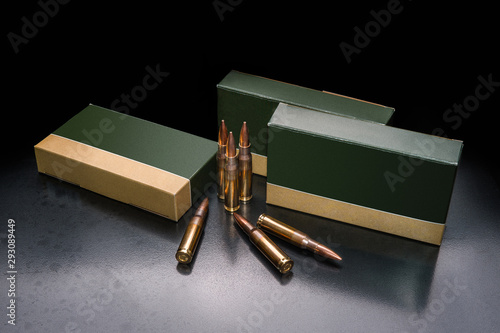 Carta da parati several boxes of ammunition for a carbine or rifle on a dark back