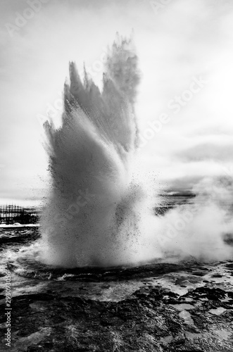 Black and white eruption of Strokkur geyser located in a geothermal area beside Fototapeta