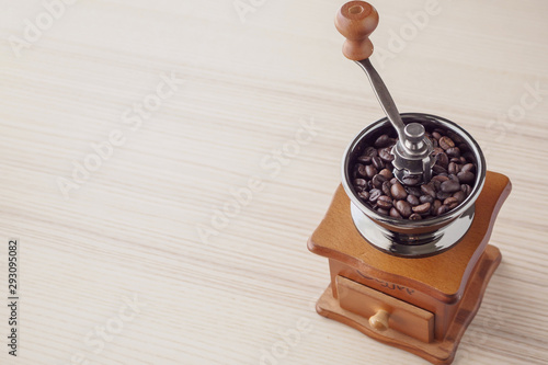 Vintage manual coffee grinder with roasted coffee beans Wallpaper Mural