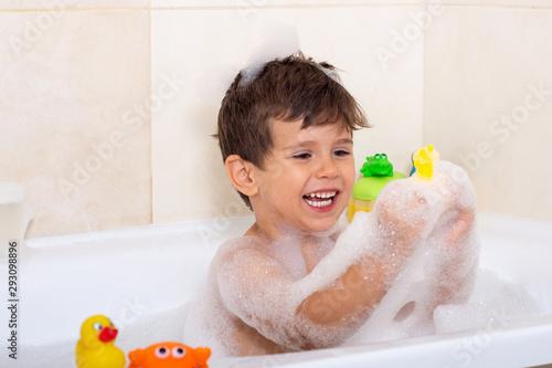 Billede på lærred Baby wash in the bath. Little boy in the bathtub. Bath time.