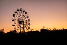 Silhouette Of A Ferris Wheel A...