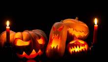 Photo Of Halloween Pumpkins With Burning Mouths, Candles On Empty Black Background