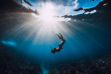 Woman Freediver With Fins Unde...