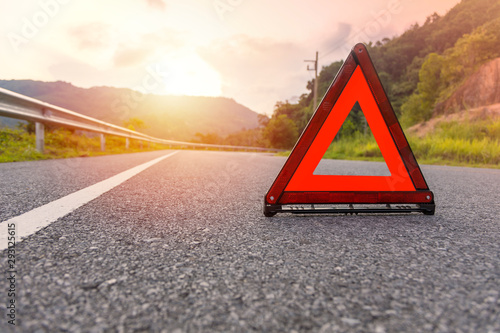 Red triangle, red emergency stop sign, red emergency symbol on road Fototapet