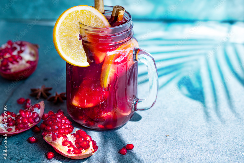 Fototapety, obrazy: Hot drink. vitamin soft pomegranate drink for health with cinnamons spices, anise star and orange. concept of vitamin drink for winter menu. hot drink for winter. bright sunlight. copy space