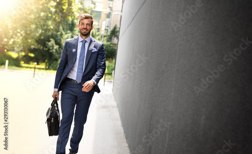 Businessman walking outside the business building