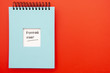 canvas print picture - Notepad on red background with copy space