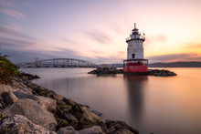Caisson (sparkplug) Style Lighthouse Under Soft Golden Light With A Bridge In The Background. Tarrytown Light On The Hudson River In New York.
