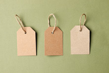 Cardboard Tags With Space For Text On Green Background
