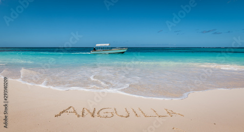 Beautiful tropical beach. Anguilla written in white sand. Wallpaper Mural