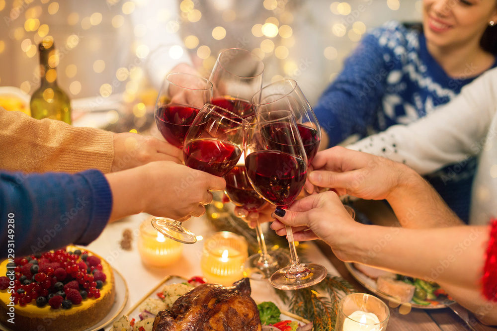 Fototapety, obrazy: holidays and celebration concept - close up of happy friends having christmas dinner at home, drinking red wine and clinking glasses