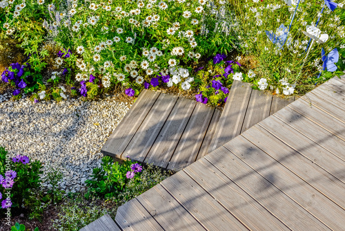 Fotomural beautiful terrace and wooden driveway in the blooming garden