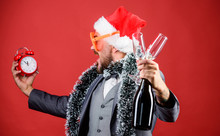 Join Office Party. Winter Party Ideas. Almost Midnight. Time To Celebrate New Year. Christmas Party. Man Bearded Hipster Santa Hat Champagne Bottle. Alarm Clock. Corporate Party. Cheers Concept
