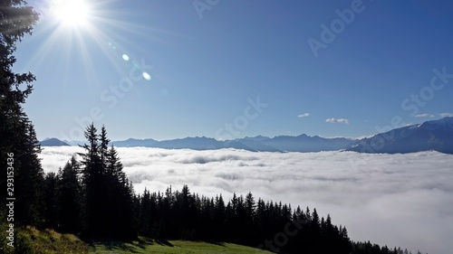 Aluminium Prints blue clear sky on the mountains with view of a foggy valley and the alps