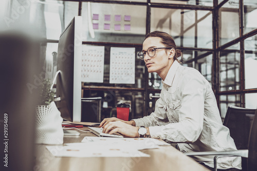 Concentrated young looking at screen of computer Canvas Print