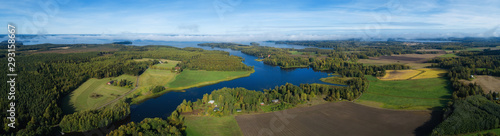 Foto auf Gartenposter Fluss Beautiful countryside landscape with fields, river, forest and huge lake. Aerial panorama of Finland on autumn.