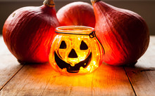Halloween Decoration Concept. Scary Jack-o-lantern Candle Holder With Pumpkins On Old Wooden Background