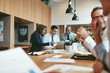 Leinwanddruck Bild - Smiling group of diverse businesspeople working together in an o