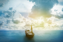 Old Boat Floating On The Sea With Cloudy Sky